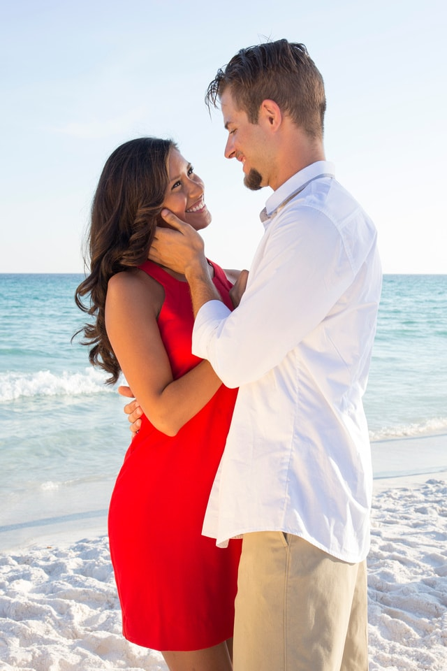 Couple embracing in Destin on the beach