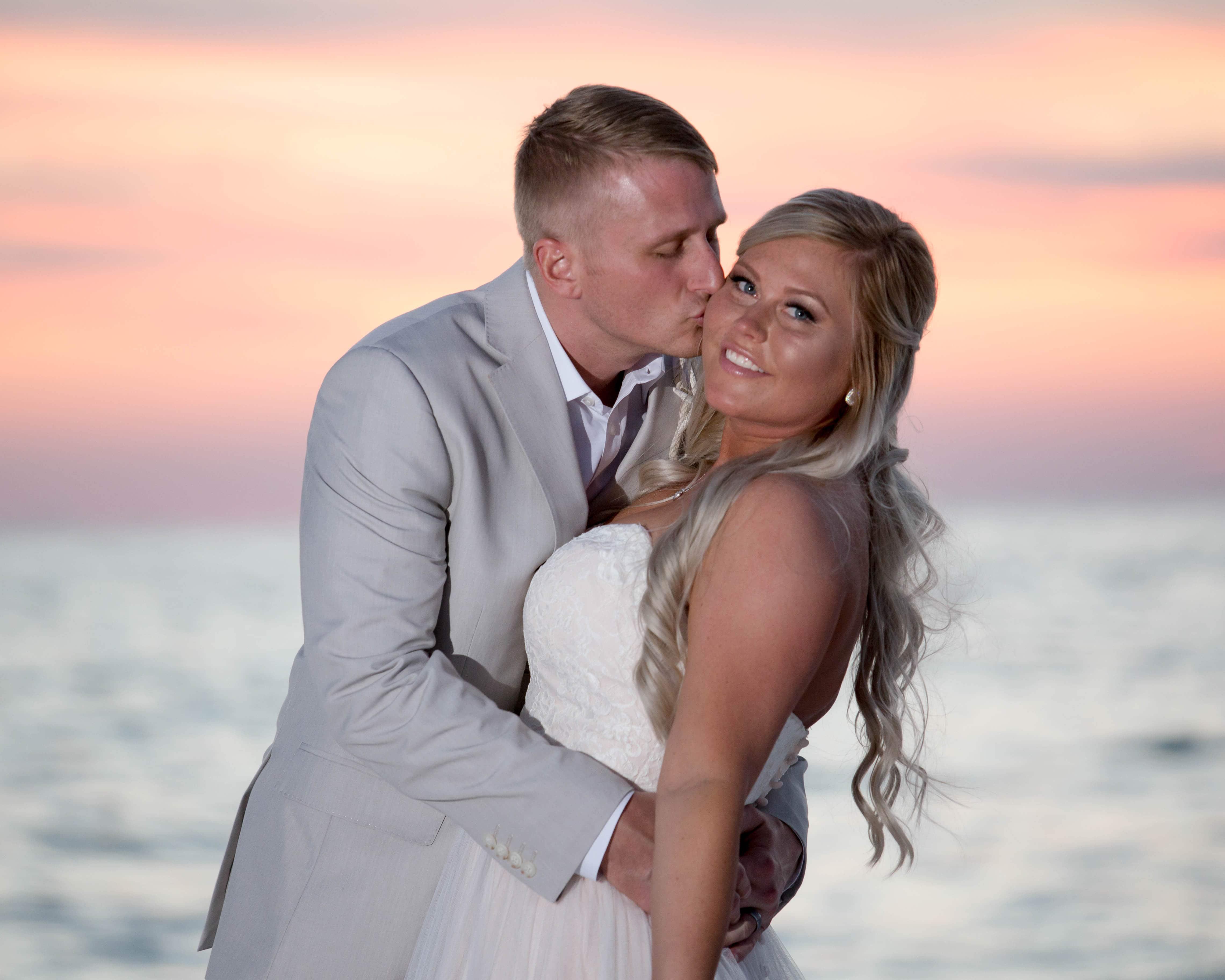 sunset wedding kiss in destin
