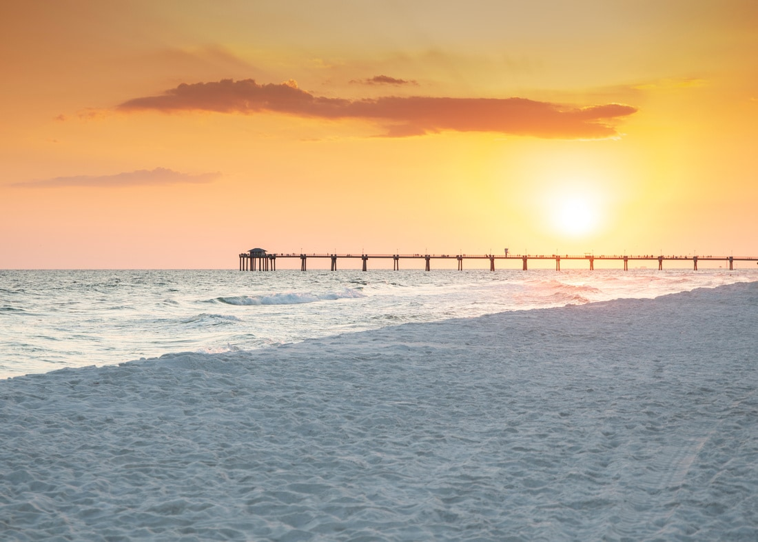 Sunset over the water at the Okaloosa Island pier